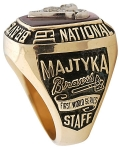 Notice that all staff members and on players have STAFF on the sides of their rings.  The ring in auction # 190285925984